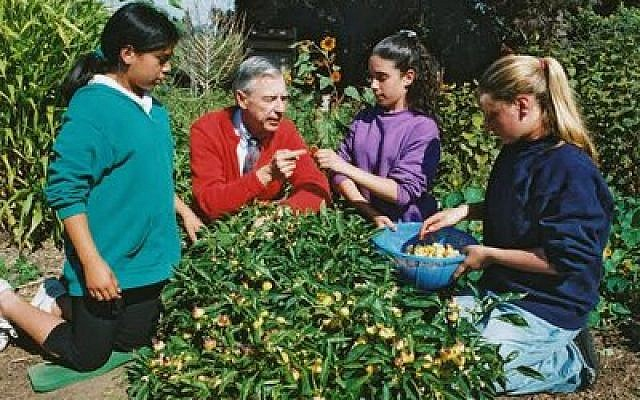 The late Fred Rogers, seen here discussing gardening with children, is this year's recipient of the Pursuer of Peace Award presented by Rodef Shalom Congregation. (Photo courtesy of Rodef Shalom)