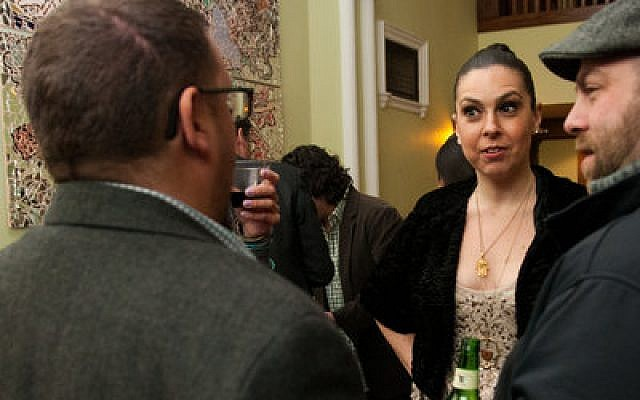 Vanessa Hidary, also know by her stage name, the Hebrew Mamita, chats at a mixer prior to her spoken word performance, Thursday, Feb. 6, at the Union Project in Highland Park. The show, which was sponsored by the Holocaust Center of the Jewish Federation of Greater Pittsburgh, was intended to reach a young Jewish audience. (Chronicle photo by Lindsay Dill)
