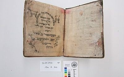 Before treatment by the National Archives and Records Administration, a Passover haggadah from 1902 recovered from the Mukhabarat, Saddam Hussein's Intelligence Headquarters. The haggadah is part of what has become known as the Iraqi Jewish Archive. (Credit: National Archives and Records Administration)