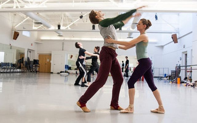 "Pittsburgh Ballet Theatre dancers Alexandra Kochis and Nicholas Coppula, who portray the bride and bridegroom in ""Ketubah,"" rehearse for the upcoming opening of the ballet. (Chronicle photo by Lindsay Dill)"