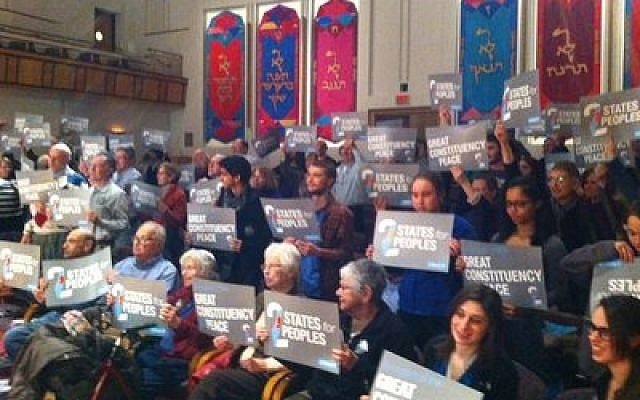 Audience members at the Monday, March 3, OneVoice program hold up signs in support of a two-state solution. (Photo courtesy of Nancy Bernstein)