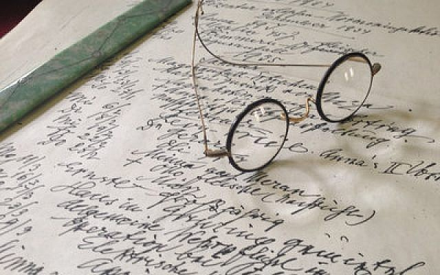 Sigmund Freud's spectacles on his desk at the Freud Museum, London (Tim Kirby © Oxford Film & Television 2012)