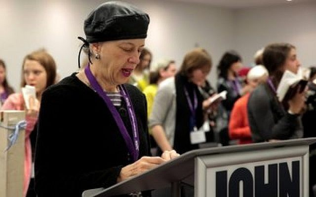 Ruth Lockshin of Toronto leads a partnership minyan at a conference in New York of the Jewish Orthodox Feminist Alliance, December 2013. (JTA photo, Mike Kelly)
