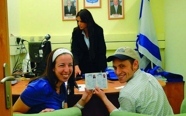 Guest columnist Melody (Mostow) Coven happily shows off her Israeli citizenship ID. Her husband is with her.
