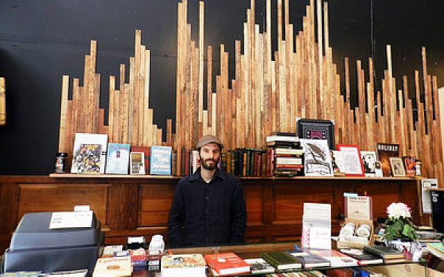 Amazing Books owner Eric Ackland, pictured above in his store's flagship Downtown space, has high hopes for the bookstore's new Squirrel Hill location.