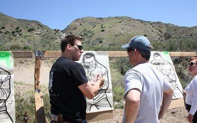Itamar Gelbman (left) and Sam Shink inspect a target.