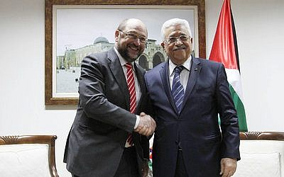 Hamas' reconciliation agreement with the Fatah movement of PA President Mahmoud Abbas (right), pictured here with European Parliament President Martin Schulz, would mean EU funds for terrorists.