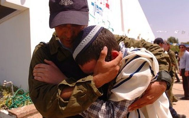 An Israeli soldier comforts a Jewish resident while evacuating the Israeli community of Morag during the August 2005 unilateral Israeli disengagement from Gaza.  Unilateralism has been a taboo subject in Israel since the perceived failure of the Gaza disengagement due to the rise of the terrorist group Hamas there, but a growing number of respected Israeli leaders are proposing unilateral moves in the wake of the recent Palestinian unity pact between Fatah and Hamas.