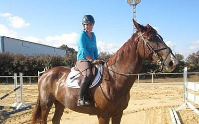 Equestrian show jumper and Olympic hopeful Danielle Goldstein practices her routine in central Israel.