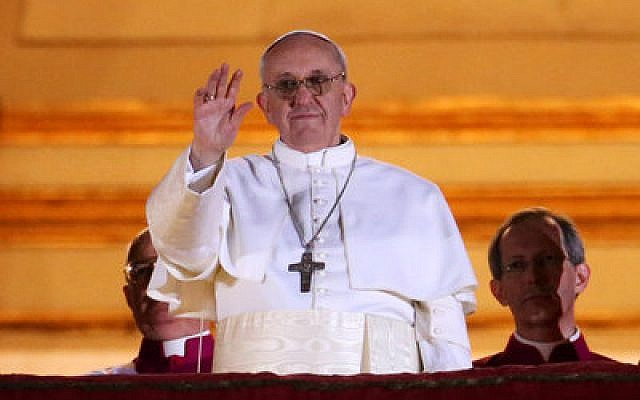 Pope Francis I waves to the crowd from the central balcony of St. Peter's Basilica in Vatican City.