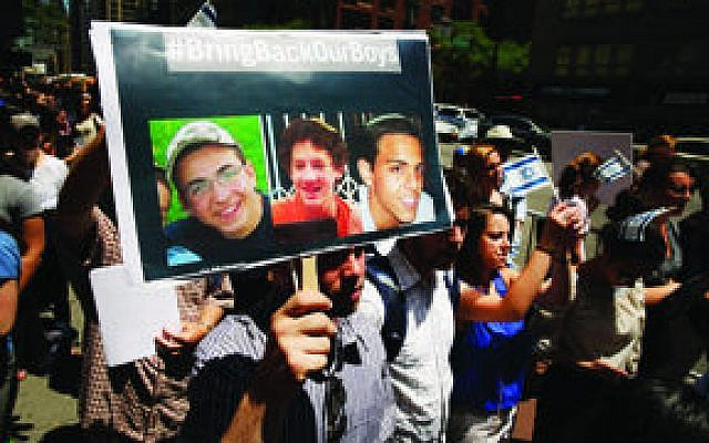 People gather for a vigil for the three missing Israeli teens outside of the Israeli Consulate in New York City on Monday. According to the Israeli Defense Forces, Gilad Shaar, Naftali Frenkel and Eyal Yifrach have been missing since June 12 and were last seen around Gush Etzion. (Photo by Spencer Platt/Getty Images)