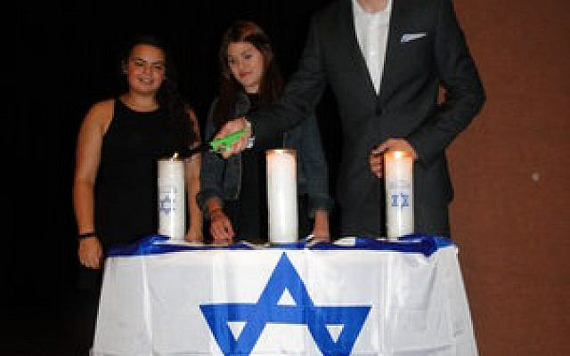 Candles were lit in memory of each victim. (Photo provided)