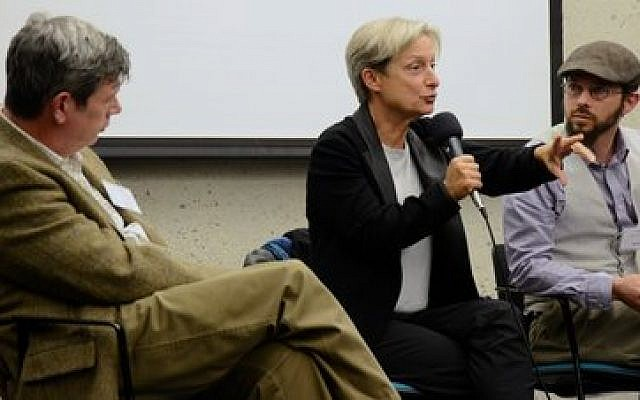 Judith Butler, flanked by Steven M. Cohen (left) and David Harris-Gershon, makes a point during the inaugural Open Hillel conference at Harvard University. (Photo by Gili Getz)