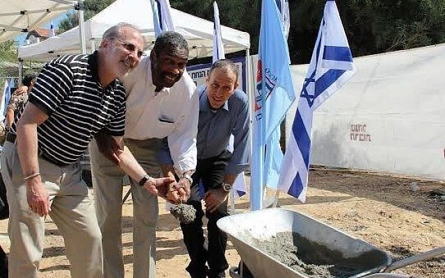 Mark Frank, Bill Strickland and Akko Mayor Shimon Lankri break ground on the new Northern Israel Center for Arts and Technology. (Photo provided)