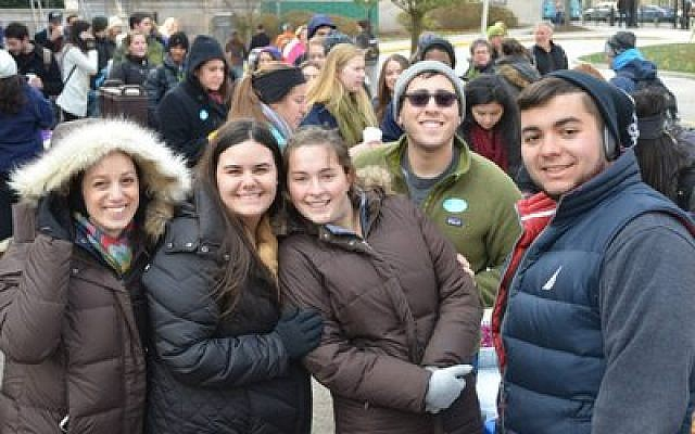 A large gathering of Pitt students was among the nearly 200 people who braved cold temperatures to enjoy free kosher and halal Middle Eastern fare. (Photo provided by Panthers for Israel)