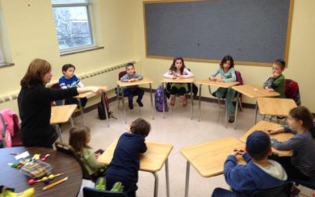 "Chani Altein leads a group of ""released-time"" students in Jewish learning last year."