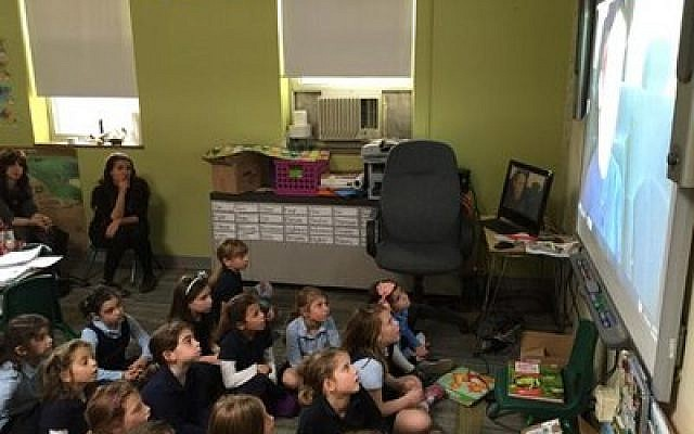 Hillel Academy students watch a video prepared by the Magen Yeladim Child Safety Institute.   (Photo provided by Hillel Academy)