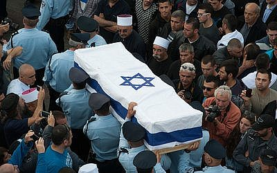 Members of the Israeli police carry the coffin of Druze police officer Zidan Saif during his funeral in the northern village of Yanuh-Jat on Nov. 19. Saif was killed while trying to save Jewish worshippers from Palestinian terrorists who had attacked a Jerusalem synagogue. (Photo by Flash90)
