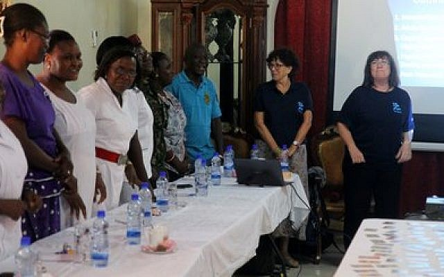 IsraAid psychosocial trauma specialists Hela Yaniv, left, and Sheri Oz leading a counseling and training session for service providers in Sierra Leone, Oct. 27. (Photo provided by IsraAid)