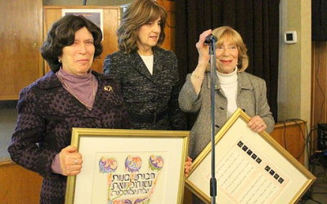 Top: Incoming Mikvah Association president Jennifer Lebovits (center) enjoys the standing ovation for honorees Surah Brodie (left) and Faithe Milch. (Photo provided)
