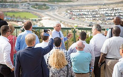 Benny Kasriel, mayor of Maale Adumim in the West Bank, speaks to a group of European politicians. (Photo provided)