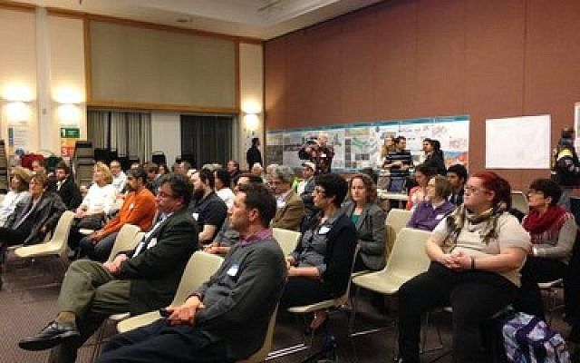 Community members listen as teams of students present their proposals on improving the Gateway. (Photo by Marian Lien)