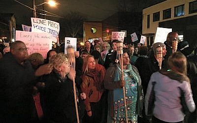 Demonstrators organize themselves to create a human-unity menorah in Squirrel Hill on the last night of Chanukah. (Photo by Bee Schindler)