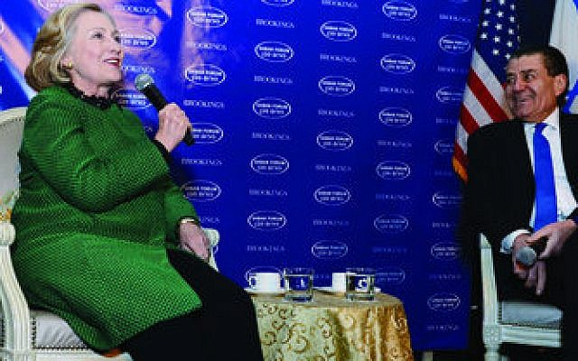 Hillary Rodham Clinton, with Haim Saban, makes a point at the Israeli-American entertainment mogul's annual forum at the Brookings Institution. (Photo by Peter Halmagyi)