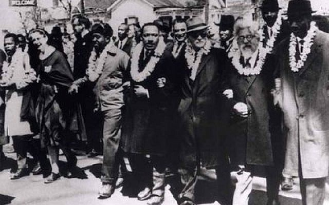 Rabbi Abraham Joshua Heschel, second from right, participates in the civil rights march from Selma to Montgomery, Ala., on March 21, 1965. (Photos provided by Susannah Heschel)