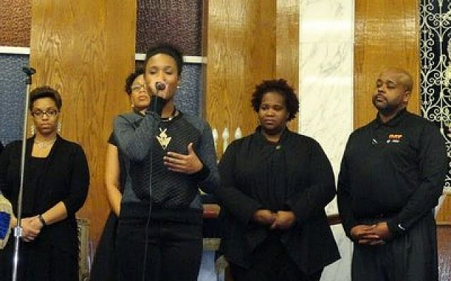 A gospel singer with the Rodman Street Missionary Baptist Church's Ensemble Choir performs for the New Light Congregation's MLK Day commemoration. (Photo by Barry Werber)