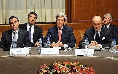 Secretary of State John Kerry is flanked by Foreign Minister Wang Yi of China and Foreign Minister Laurent Fabius of France at U.N. headquarters in Geneva following nuclear talks with Iran in November 2013. Some U.S. lawmakers fear that a focus on fighting ISIS will distract from preventing a nuclear Iran. (Photo provided by Wikimedia Commons)