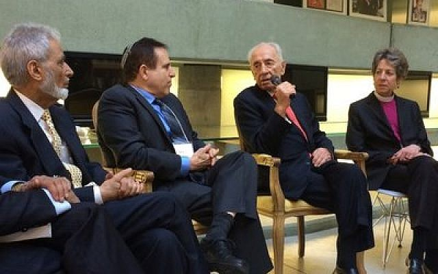 Former Israeli President Shimon Peres, with microphone, meets in Tel Aviv Jan. 20 with (from left) Sayyid Syeed of the Islamic Society of North America, Rabbi Steve Gutow of the Jewish Council for Public Affairs and Katharine Jefferts Schori, presiding bishop of the Episcopal Church of the United States. (Photo provided by JCPA)