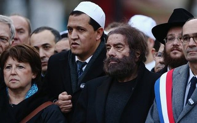 Marek Halter, second from right, and Hassen Chalghoumi, in white cap, attend a mass rally in Paris following  the shootings at the Charlie Hebdo magazine and the Hyper Cacher supermarket on Jan. 11.