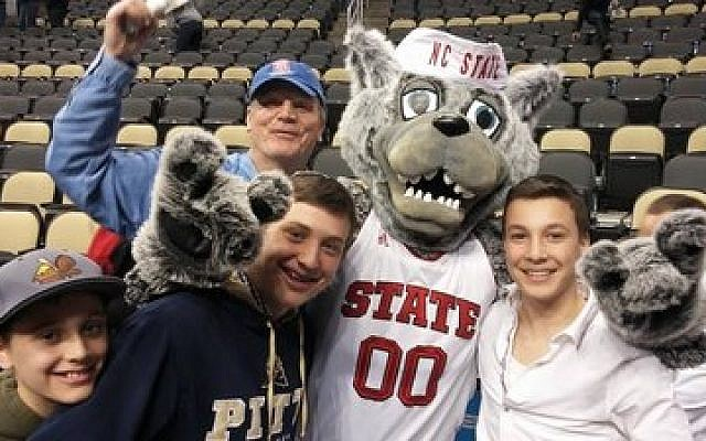 Jewish basketball fans get some attention from the North Carolina State mascot.