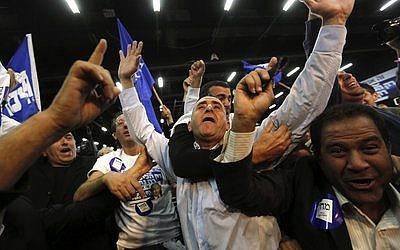 Likud Party supporters in Tel Aviv react after hearing exit poll results, which showed that Prime Minister Benjamin Netanyahu's Likud Party had surged ahead of Isaac Herzog's Zionist Union in Tuesday's election.