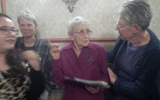 Edith Bell (left) talks with one of the event's attendees. (Photo by Adam Reinherz)