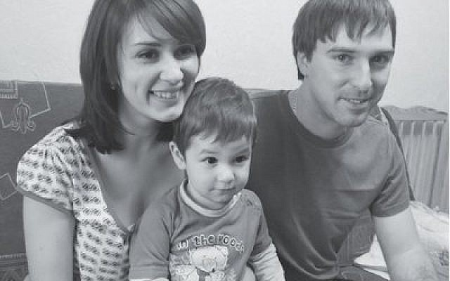 Ilya and Luba Tolkachov and their 22-month-old son live in a tiny one-room Kiev apartment, which they share with with Ilya's mother. (Photo by Ben Sales)