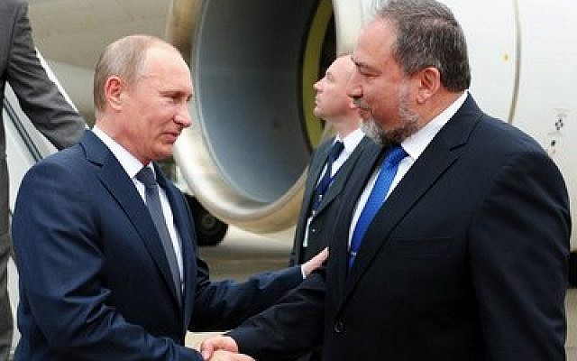 Russian President Vladimir Putin is greeted by Israeli Foreign Minister Avigdor Liberman at Ben Gurion Airport in 2012. (Photo by Kobi Gideon/Israel Government Press Office)