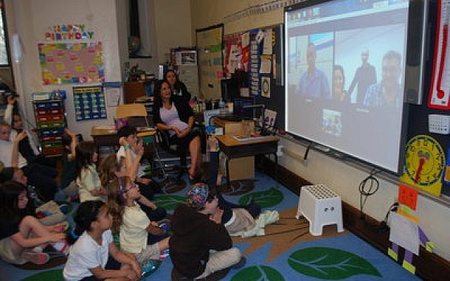 First-graders at Community Day School enjoy Skyping with Israeli runners. (Photo provided by Community Day School)
