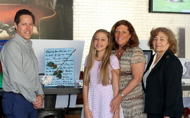 Community Day School's Andrea Holber was the middle school first-place winner, using the writings of Sophia Scholl as her inspiration. Scholl was a member of the anti-Nazi student resistance group The White Rose. Pictured with Andrea are her parents, (from left) Thomas Holber, Linda Safyan-Holber and Andrea's grandmother, Martha Printz Safyan. (Photo by Simone Shapiro)