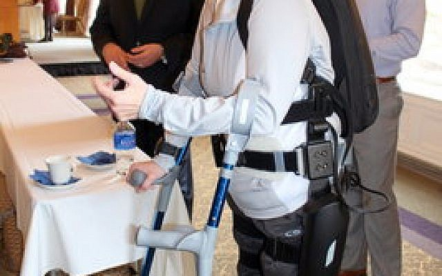 """Army veteran Terry Hannigan, a paraplegic, says the exoskeleton from ReWalk """"has given me back my independence and my life."""" (Photo by Simone Shapiro)"""