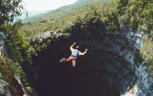 Omer Mei-Dan, pictured above jumping into Mexico's 1,200-foot-deep Cave of Swallows, stands out among BASE jumpers because he has found a way to combine his passion for extreme sports with his other passion, medicine. (Photo provided by JTA.org)