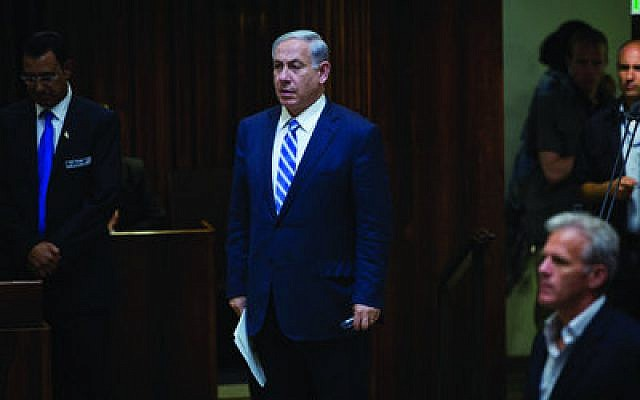 Israeli Prime Minister Benjamin Netanyahu, shown in the Knesset last week, pulled together a government coalition just 90 minutes before the deadline. (Photo by Miriam Alster/Flash90)