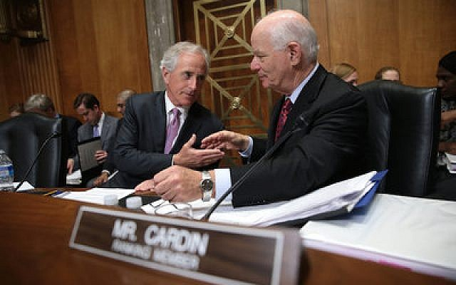 Senate Foreign Relations Committee chairman Sen. Bob Corker (R-Tenn.) reaches out to shake hands with ranking member Sen. Ben Cardin (D-Md.) during a committee markup meeting last month on the proposed nuclear agreement with Iran. (Photo by Win McNamee/Getty Images)