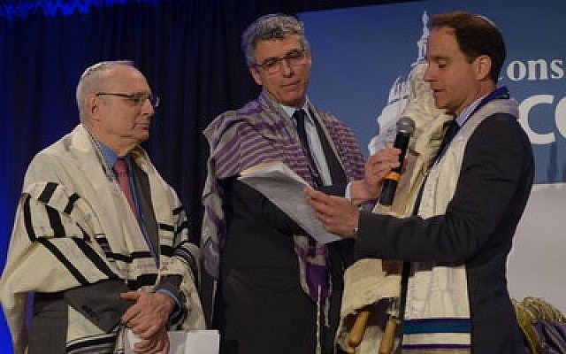 Rabbi David Saperstein (left), the longtime leader of the Reform Action Center, and Rabbi Rick Jacobs (center), president of the Union for Reform Judaism, hand the reigns of the RAC over to Rabbi Jonah Dov Pesner. (Photo by Pat Jarrett)