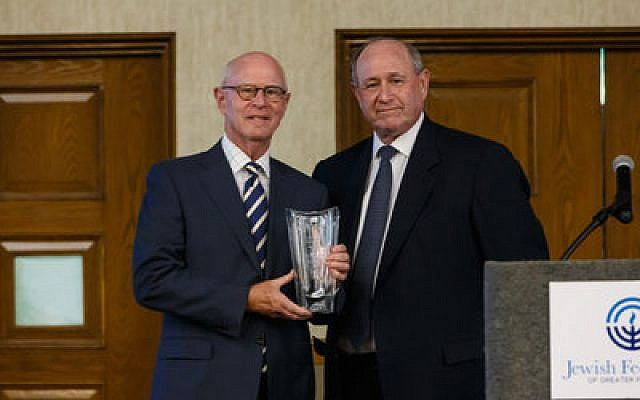 Richard Wagner (left) accepts the PNC Community Builders Award from PNC president Sy Holzer. (Photo by David Bachman)