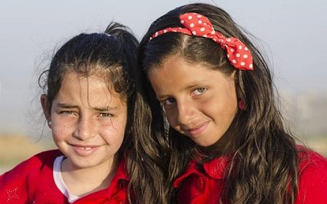 Two Samaritan girls smile for the camera. (Photo by Dale Lazar)
