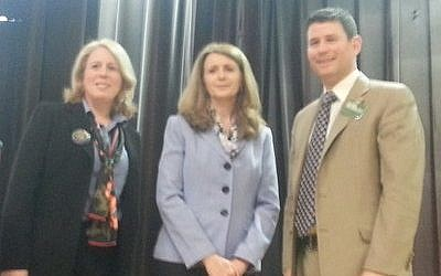 Lynda Wrenn (left) and Kirk Burkley pose with moderator Cindy Morelock at the conclusion of their District 4 debate. (Photo by Dave Rullo)