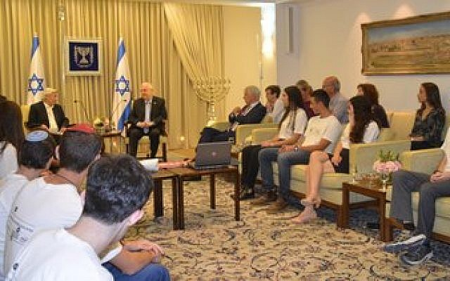 Israeli high school students meet with President Reuven Rivlin before going overseas for major science competitions. (Photos by Sharon Altshul)