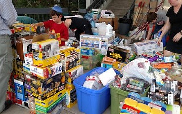 Volunteers at the Evelyn Rubenstein JCC busy handing out supplies to help in the recovery. (Photo provided by Jewish Federation of Greater Houston)